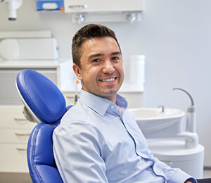 Smiling new patient in dentist chair