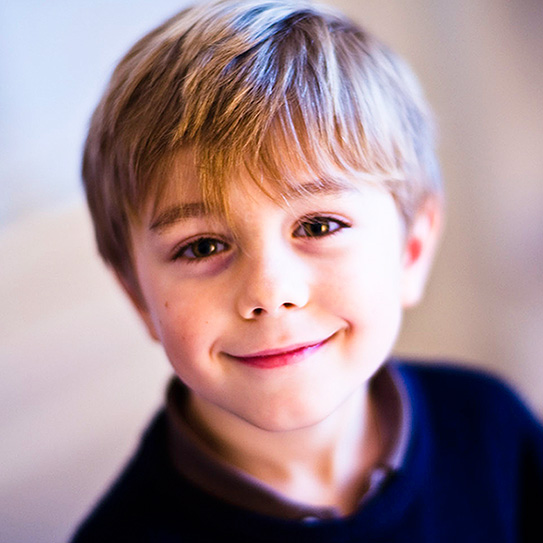 little boy smiling at camera