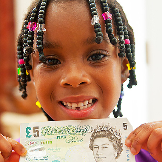little girl holding money from tooth fairy