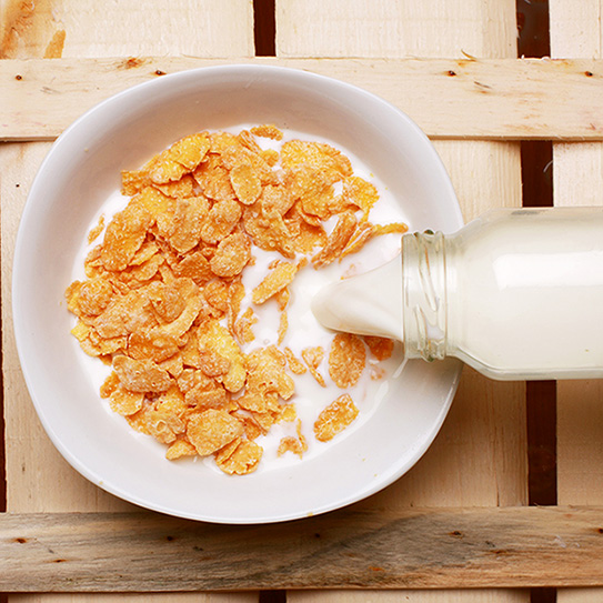 milk pouring into cereal