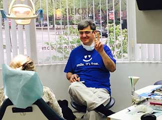 dentist smiling and giving peace sign