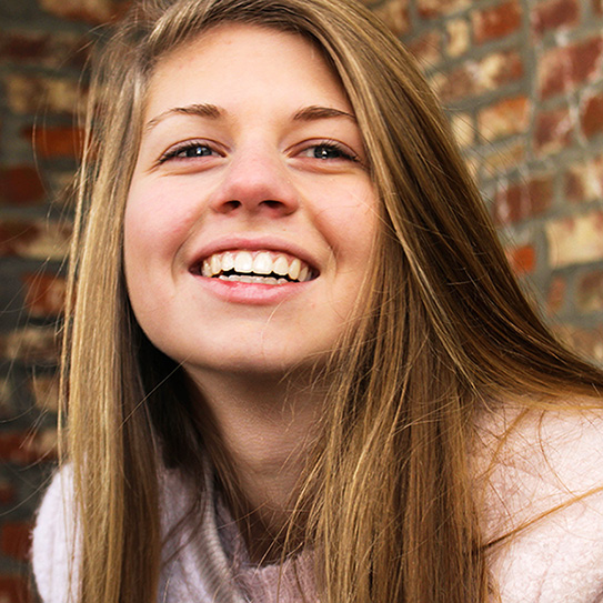 teenage girl looking up and smiling