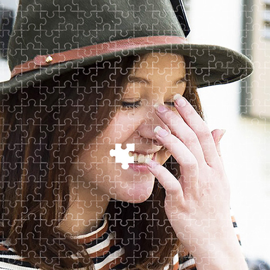 woman with puzzle over face