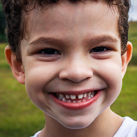 close up of boy smiling