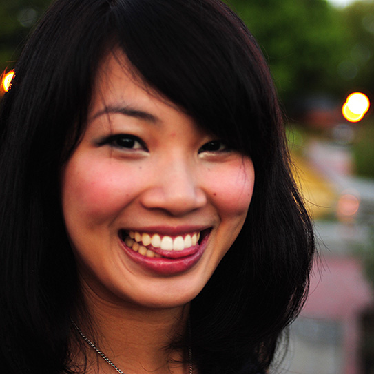 woman smiling and sticking tongue out