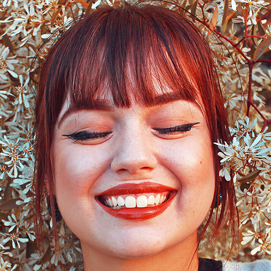 woman smiling with bright white teeth