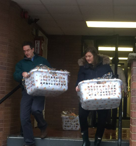 man and woman carrying gift baskets