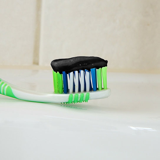 charcoal toothpaste on toothbrush