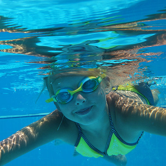 Young girl diving underwater