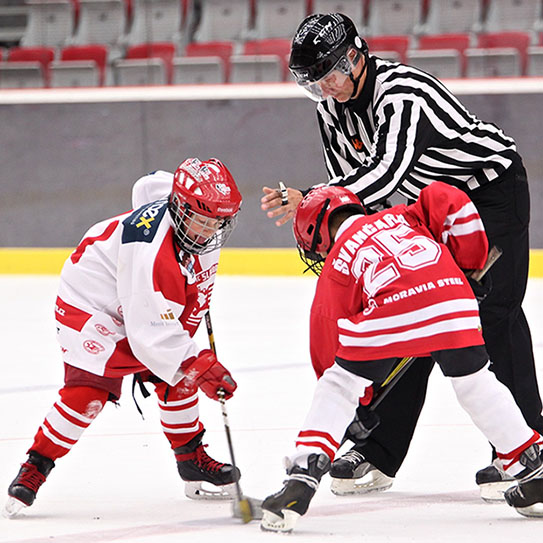 Two kids playing the game of hockey