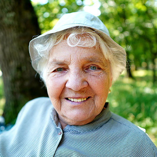 Older woman with a hat on smiling