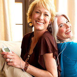 two middle aged woman listening to music