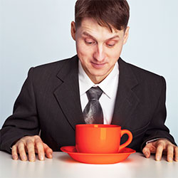 man looking at coffee mug