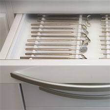 drawer filled with dental equipment